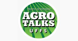 """Selo do projeto Agro Talks. O selo é redondo, com fundo em duas tonalidades de verde, no formato como se fossem raios de sol. O texto no selo é: """"Porjeto de Extensão Agro Talks UFFS"""""""