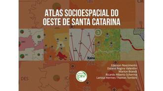 Imagem da capa do atlas, em cores terrosas e mapas
